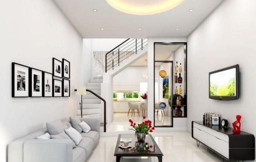 Trang trí phòng khách đẹp cho nhà lắp cửa cuốn đẹp bắt mắt